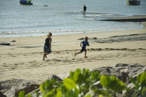 Springa ikapp på stranden